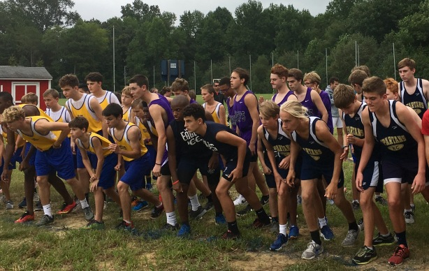 The varsity boys team lines up for a race against several other schools at Wayne country day.