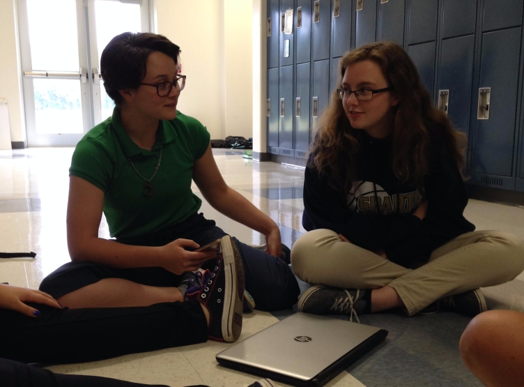 Every day at lunch, twelfth grader Laney Rivera and eleventh grader Maddie Singleton sit in the exact same spot with a few other girls, completing homework and cracking jokes. Because there are only three girls in the junior class, many of their close friends are from other grades. Photo taken by Bethany Lee.