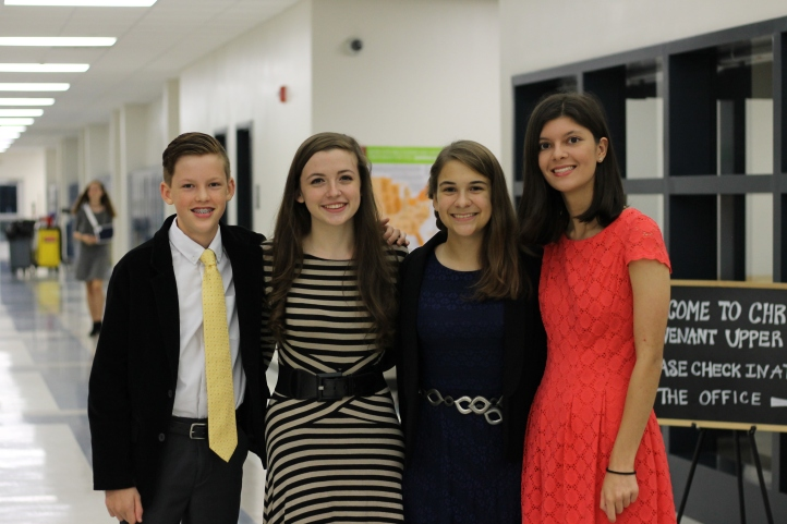 Tenth graders Mason Verhaeghe, Mackenzie Faulk, Laura Stroud, and Natalie Draper pose before going to sit with their parents in the audience. Photo taken by Lisa Stroud.