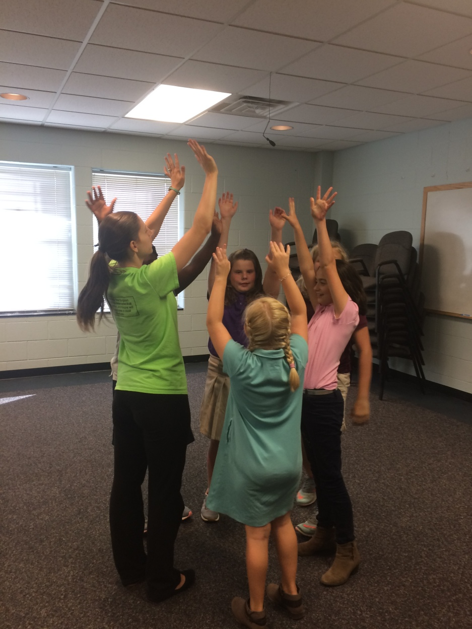 Young Actors Workshop, held at the lower school, concludes for the day with a hands-up celebration proclaiming a job well done. Photo taken by Mason Mattox.