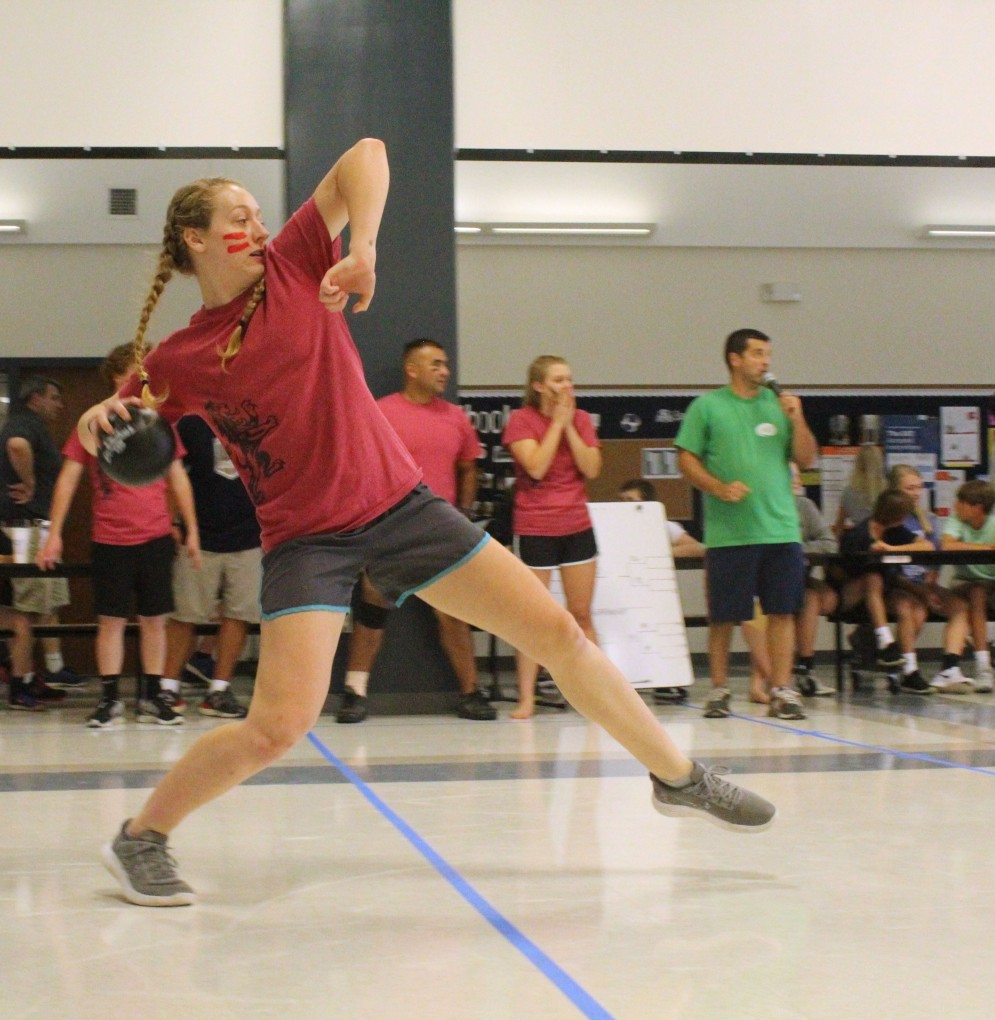 """House of Paul member, or """"Paulian,"""" and twelfth grader Bethany Lee, prepares for a powerful throw during the House dodgeball challenge."""