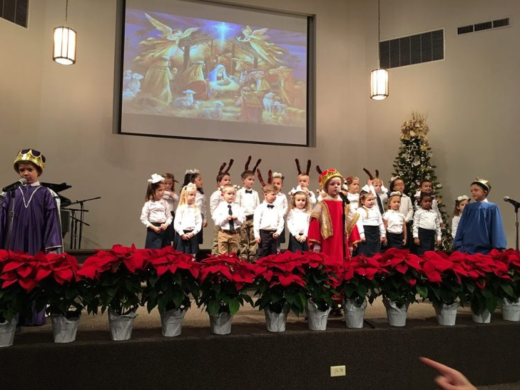 The lower school music class performs at the Christmas concert.