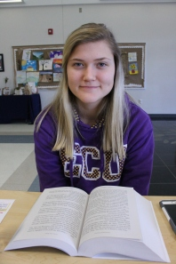 Kelly Harris, 12, reads from her favorite saga during lunch at the upper school.