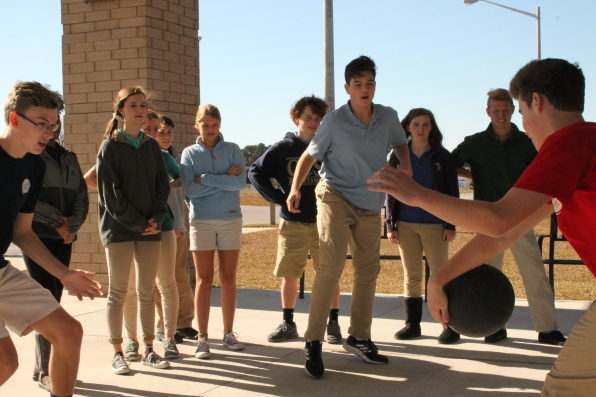 Upper school students with frantic feet play a game of four square during lunch at the upper school.