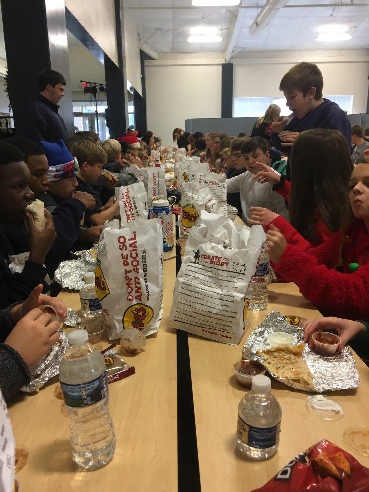 Upperclassmen enjoy Moe's at hot lunch on Friday, December 15, 2017.