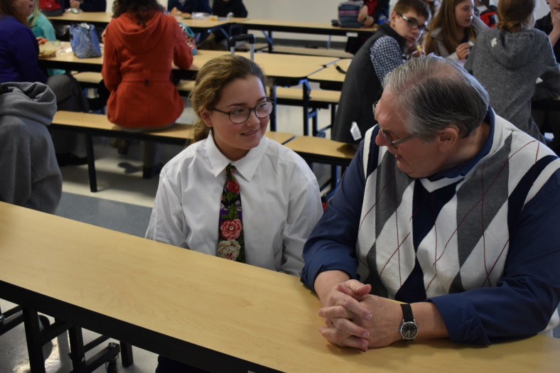 Ninth grader Laci Thomas, dressed as upper school teacher Jon Alder, chats with her look-alike at lunch on Teacher Day.