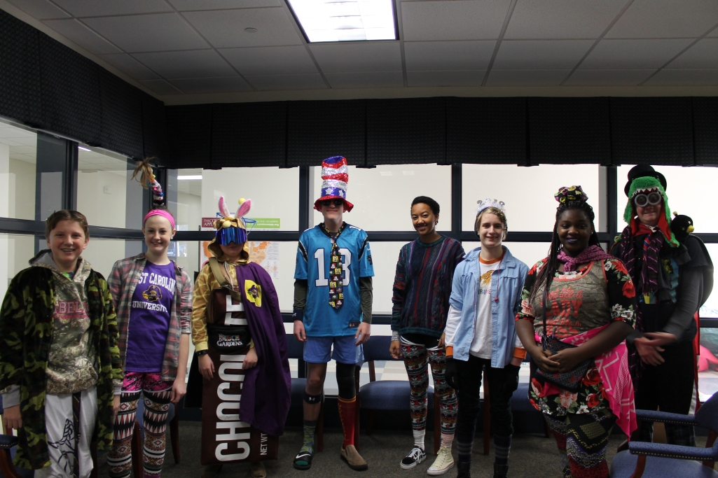 The winners for Wacky Tacky Wednesday pose in the office before the Prefect Council ranks the top three candidates.