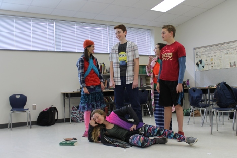 Tenth grader Natalie Draper, ninth grader Tucker Winslow, and twelfth graders William Snowden and Bethany Lee rest in their blocked positions at rehearsal for The Music Man during Wacky Tacky Day.