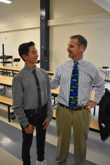 Seventh grader Vandad Shojaei poses with his look alike, headmaster Robert Lee, on Teacher Day during lunch.