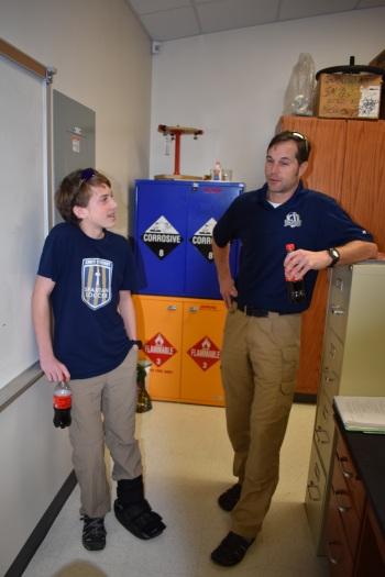 Ninth grader William Sutton and upper school teacher Chris Mitchell discuss Sutton's first place costume on Teacher Day.